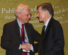 Jack Jennings (right) receives congratulations from Gary Marx after receiving the Horace Mann League's Outstanding Friend to Public Education Award during the 2012 AASA national conference in Houston.
